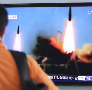 A man watches a TV news program showing the missile launch conducted by North Korea, at Seoul Railway Station in Seoul, South Korea, Wednesday, March 26, 2014.