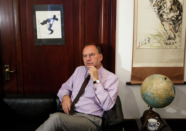 Dr. Peter Piot, director of the London School of Hygiene and Tropical Medicine, speaks during an interview with The Associated Press at his office in London, Friday, Oct. 17, 2014.