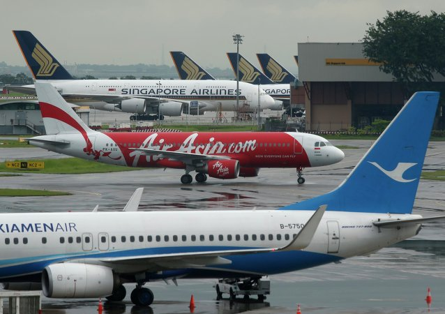 AirAsia's QZ8501 from Surabaya to Singapore, taking the same code as the missing plane which took off 24 hours earlier, taxis at Changi Airport in Singapore December 29, 2014