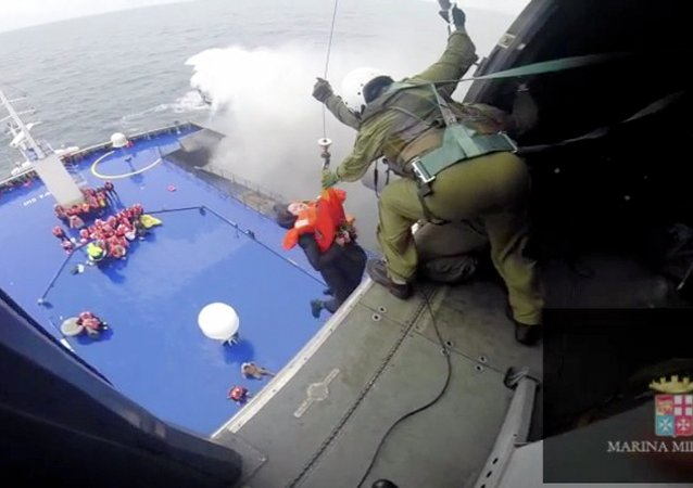 A person is lifted on an Italian Navy helicopter as the car ferry Norman Atlantic burns in waters off Greece December 28, 2014 in this handout video grab of the Italian Marina Militare