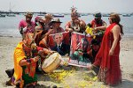 Shamans holding posters of U.S. President Barack Obama and Cuba's President Raul Castro, perform a ritual of predictions for the new year at Agua Dulce beach in Lima December 29, 2014