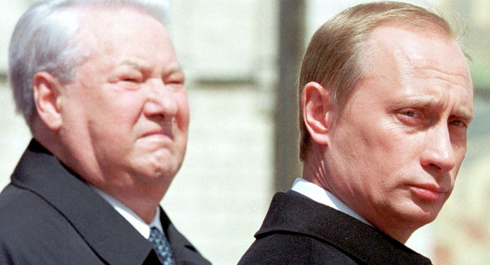 Former Russian president Boris Yeltsin (L) stands close to Russian President Vladimir Putin in Moscow in this May 7, 2000 file photo