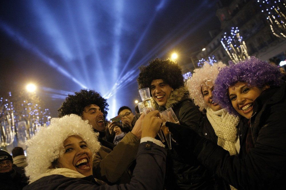Revellers celebrate the New Year's Eve on the Champs Elysees avenue in Paris, France, Thursday, Jan. 1, 2015