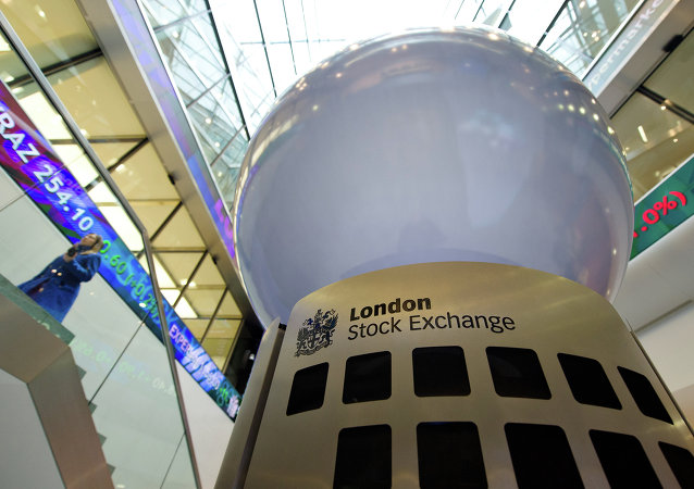 A person walks in the foyer of the London Stock Exchange in central London