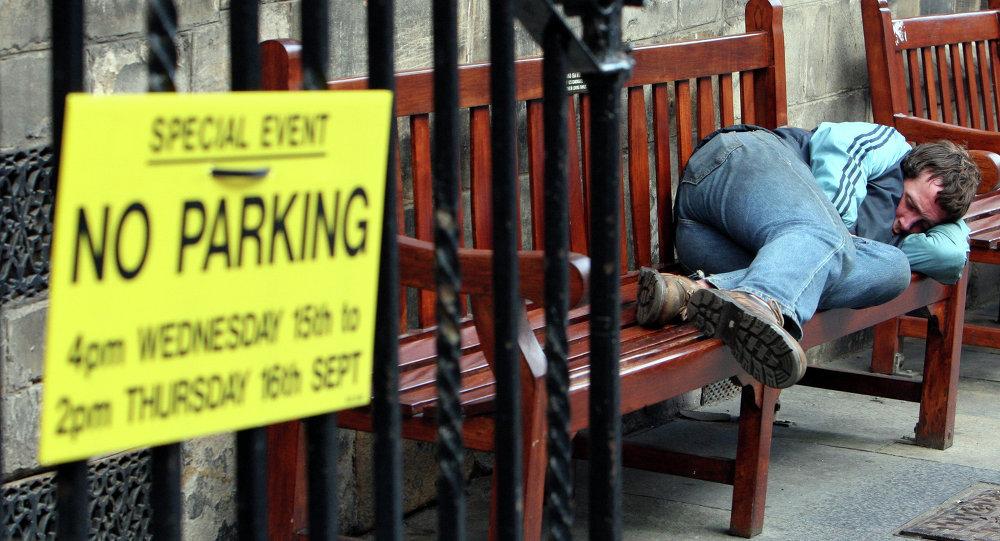 A homeless man sleep's on a bench on the royal mile in, Edinburgh, Scotland
