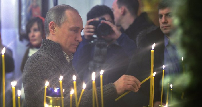 Russian President Putin attends Christmas service