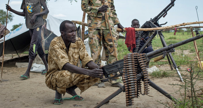 Rebel soldiers guard the village of Majieng, about 6km from the town of Bentiu, in South Sudan