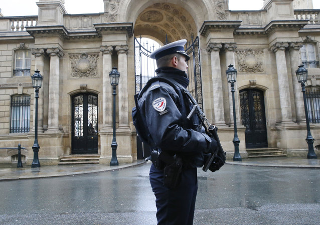 A police officer is in faction in front of the Elysee Palace in Paris