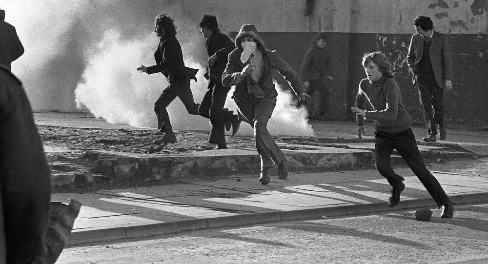 Young Catholic rioters hurl projectiles 02 March 1972 in Londonderry at British soldiers during a rally protesting the 30 January Bloody Sunday killing by British paratroopers of 13 Catholics civil rights marchers in Londonderry.