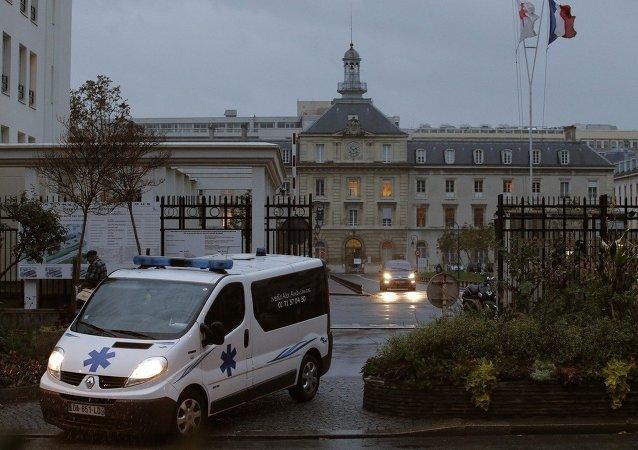 An ambulance exits the main entrance of Begin Army Training Hospital in Saint-Mande, eastern Paris