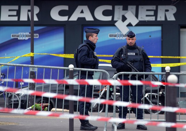 French police officers stand guard outside the Hyper Cacher kosher supermarket near Porte de Vincennes in eastern Paris