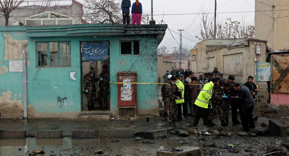Afghan security personnel investigate the site of a blast in Kabul January 13, 2015.