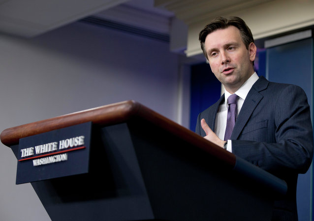 White House press secretary Josh Earnest speaks during the daily news briefing at the White House in Washington, Tuesday, Jan. 13, 2015