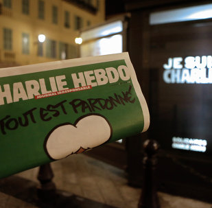Charlie Hebdo newspaper is displayed next a newsstand with a poster reading  I am Charlie in Nice southeastern France