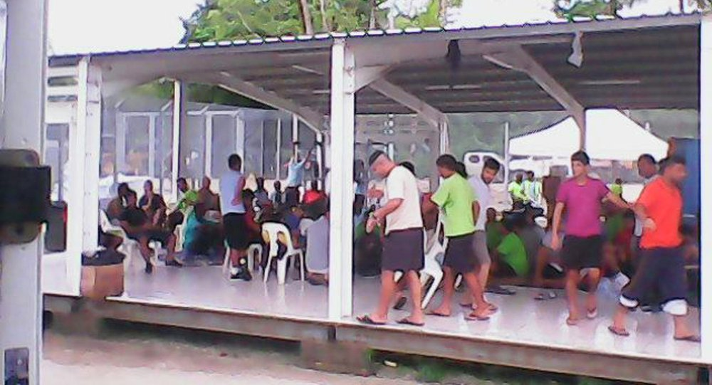 Asylum seekers are pictured in this handout photo provided by the refugee action coalition, taken inside the Manus Island detention centre in Papua New Guinea January 13, 2015