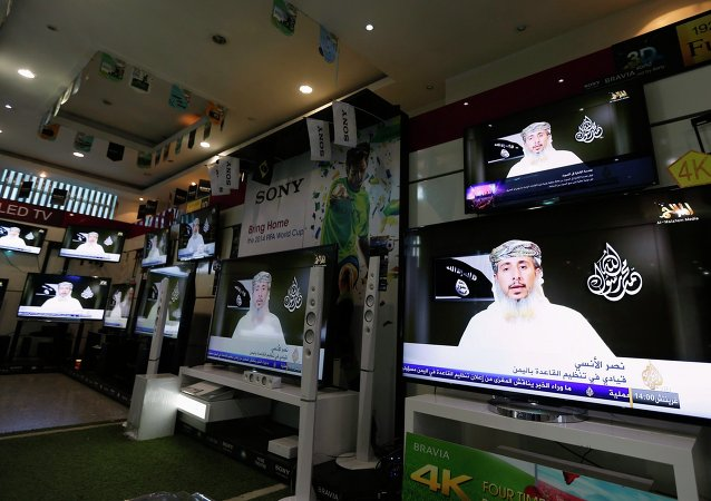 Nasser bin Ali al-Ansi, a leader of the Yemeni branch of al Qaeda (AQAP), is displayed on televisions at an electronics shop in Sanaa January 14, 2015