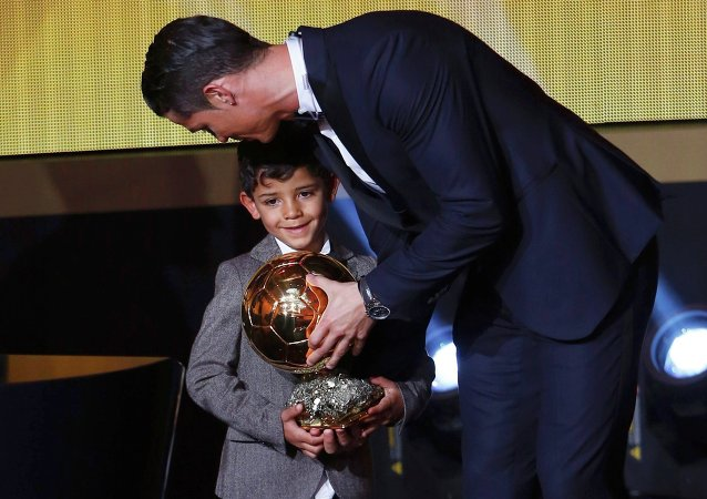 Real Madrid's Cristiano Ronaldo of Portugal, stands with his son Cristiano Ronaldo Jr, after winning the FIFA Ballon d'Or 2014 during the soccer awards ceremony at the Kongresshaus in Zurich January 12, 2015
