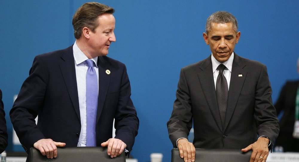 U.S. President Barack Obama and British Prime Minister David Cameron, left, take their seats at the first plenary session of the G20 summit