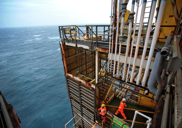 A picture shows employees working on the BP ETAP (Eastern Trough Area Project) oil platform in the North Sea, around 100 miles east of Aberdeen, Scotland on February 24, 2014