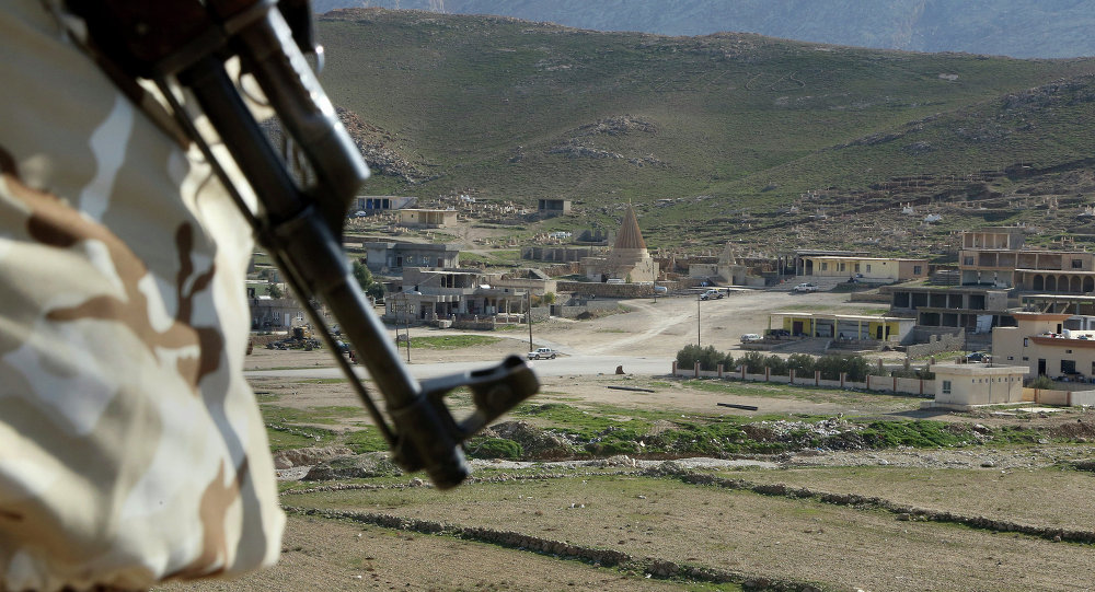 In this Sunday Jan. 11, 2015 photo, a Yazidi fighter protects the Sharaf al-Deen temple shrine, one of the holiest for the Yazidis, a religious minority whom Daesh considers heretics ripe for slaughter, in Sinjar, northern Iraq