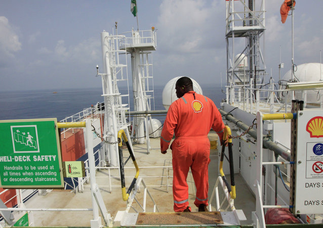 An unidentified Shell worker aboard the Bonga offshore oil vessel off the coast of Nigeria, Monday, Dec. 26, 2011