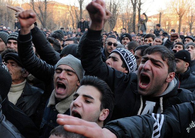 Armenian protesters shout slogans in front of the prosecutor's office in Gyumri as they demand Russian soldier Valery Permyakov accused of murdering a family of six be delivered to Armenian justice authorities for trial