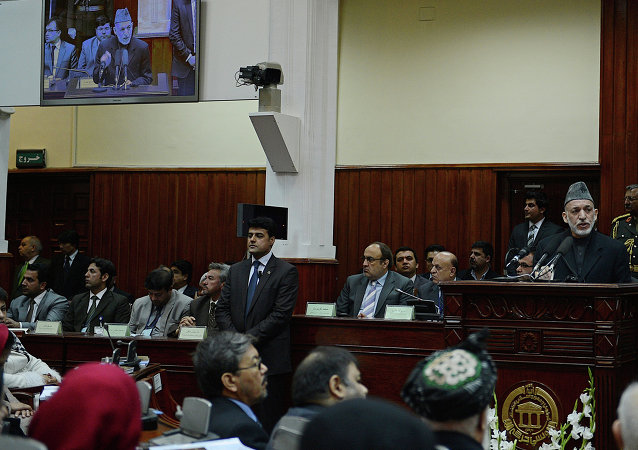 Afghan President Hamid Karzai (R) delivers a speech on the opening session of the Parliament in Kabul