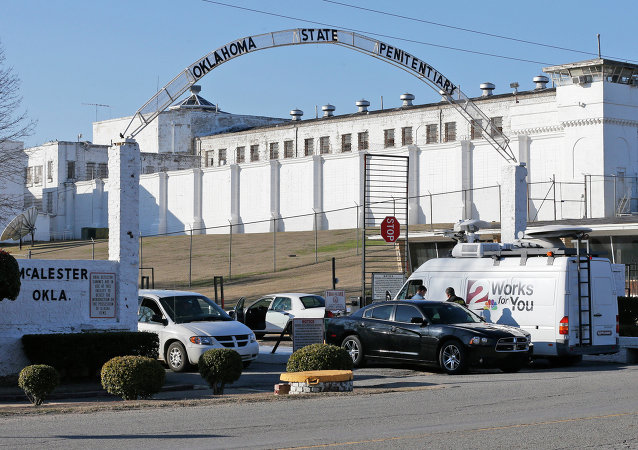 A news van arrives at the front gate of the Oklahoma State Penitentiary for the scheduled execution of Charles Warner in McAlester, Okla, Thursday, Jan. 15, 2015