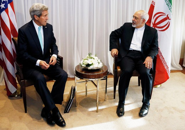 U.S. Secretary of State John Kerry sits with Iranian Foreign Minister Mohammad Javad Zarif before a meeting in Geneva January 14, 2015
