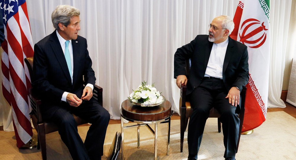 US Secretary of State John Kerry sits with Iranian Foreign Minister Mohammad Javad Zarif before a meeting in Geneva January 14, 2015