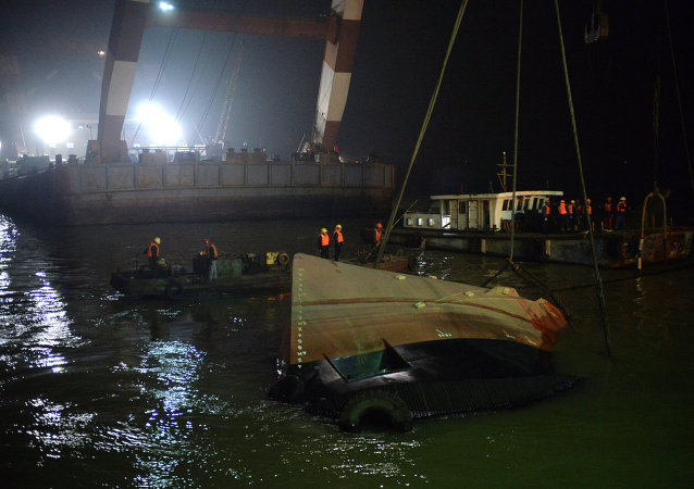 Salvage the wreck after a tug boat sank in the Yangtze River in east China's Jiangsu Province, Friday, Jan. 16, 2015.