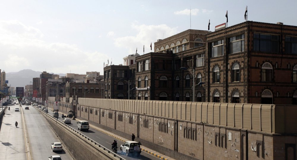 Vehicles drive past the office building of Ahmed Awadh bin Mubarak, in Sanaa January 17, 2015
