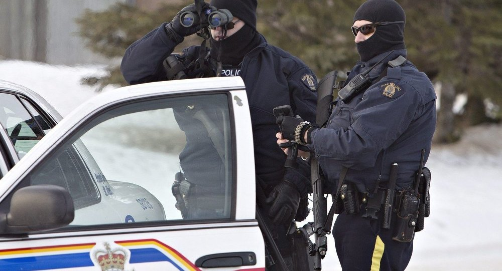 Police search for a suspect in the shooting of two RCMP officers in St. Albert, Alberta, Canada, on Saturday, Jan. 17, 2015