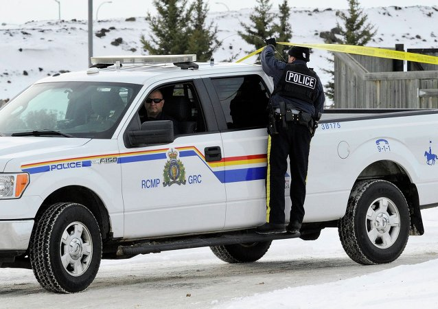 Police officers man the perimeter of a crime scene in St. Albert, Alberta, where two RCMP officers sustained significant injuries after being shot at the Apex Casino, January 17, 2015