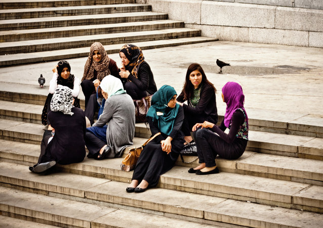 Young muslim women enjoying the afternoon at Trafalgar Square.
