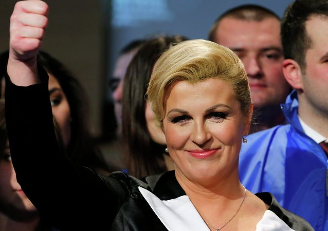 Kolinda Grabar-Kitarovic of the opposition HDZ celebrates her victory in Croatia's presidential run-off election on the stage at her campaign headquarters in Zagreb January 11, 2015.