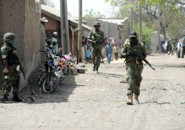 Soldiers walk in the street in the remote northeast town of Baga, Borno State.