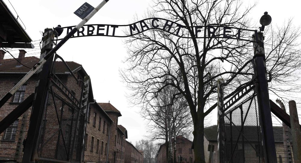 The sign Arbeit macht frei (Work makes you free) is pictured at the main gate of the former German Nazi concentration and extermination camp Auschwitz in Oswiecim