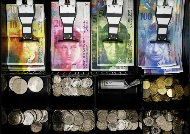 Swiss franc coins are seen in a cash drawer in this picture illustration in Bern