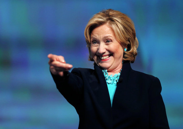 Former Secretary of State Hillary Rodham Clinton reacts as she is introduced to speak at the Massachusetts Conference for Women in Boston, Thursday, Dec. 4, 2014