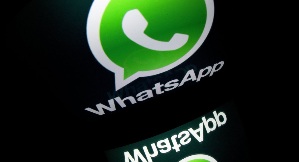 The logo of mobile app WhatsApp is displayed on a tablet on January 2, 2014 in Paris