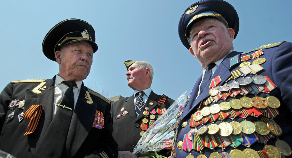 World War II veterans Albert Semushin of Moldova, left, Grigory Rekobratsky of Lithuania, center background, and Vladimir Buhenko of Moldova, meet at the World War II memorial near Volgograd, about 900 kilometers (550 miles) southeast of Moscow, Friday, May 7, 2010