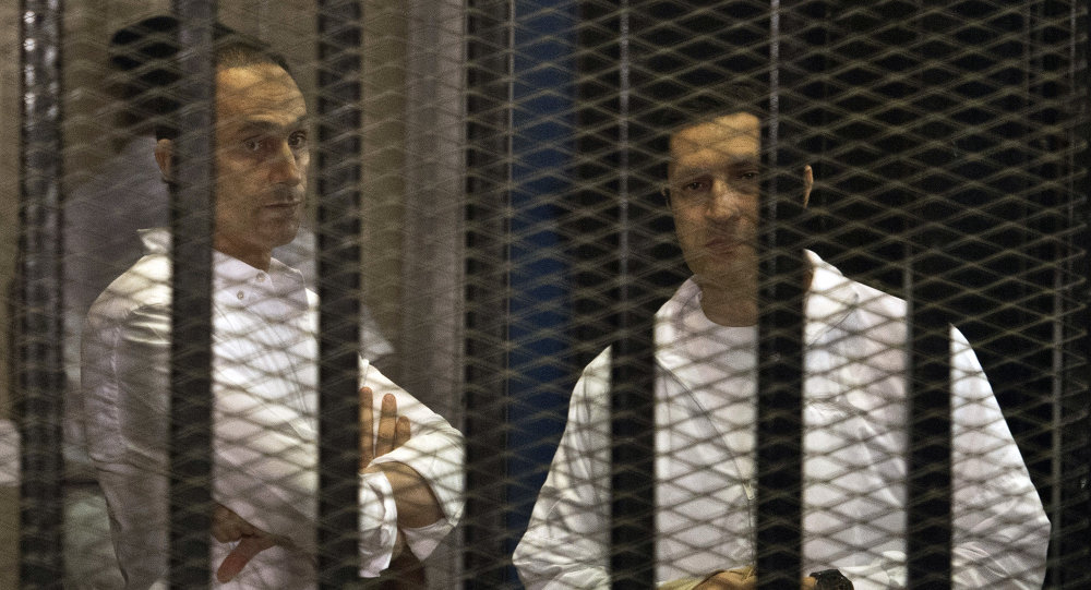 Sons of ousted Egyptian president Hosni Mubarak, Gamal (L) and Alaa (R)