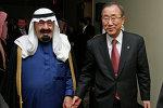 United Nations Secretary-General Ban Ki-moon (R) walks with Saudi Arabia's King Abdullah (L