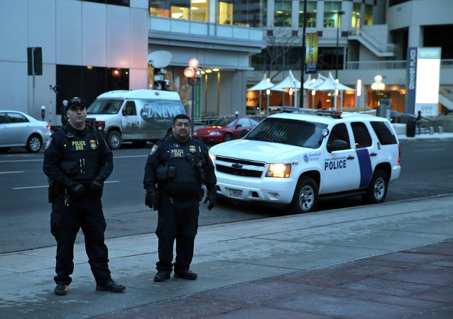 U.S. Homeland Security officers stand guard outside the U.S. Federal Courthouse at the close of the sentencing hearing for Shannon Conley, in Denver, Friday Jan. 23, 2015