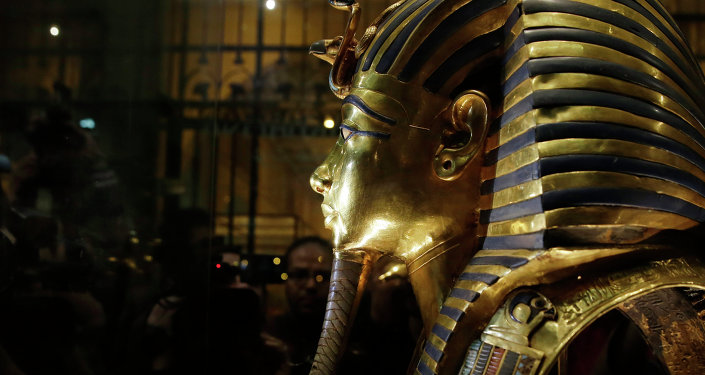 The gold mask of King Tutankhamun is seen in a glass case during a press tour, in the Egyptian Museum near Tahrir Square, Cairo, Egypt, Saturday, Jan. 24, 2015