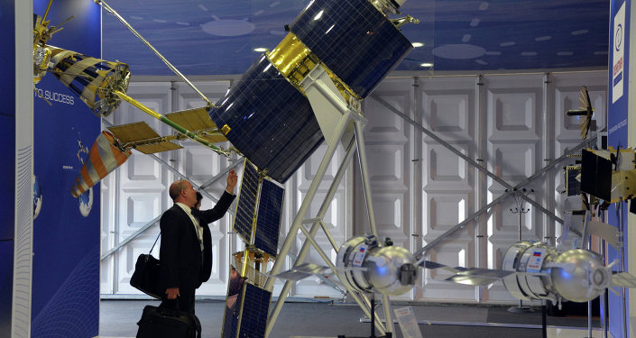 A Gonets-M satellite showcased at the Reshetnev Information Satellite Systems company's stand at the Farnborough International Airshow 2014
