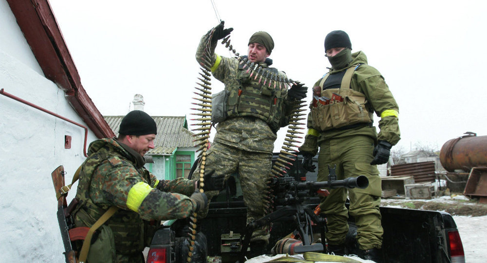 Ukrainian servicemen prepare their ammunition at a position on the frontline near the southern Ukrainian city of Mariupol on January 26, 2015.
