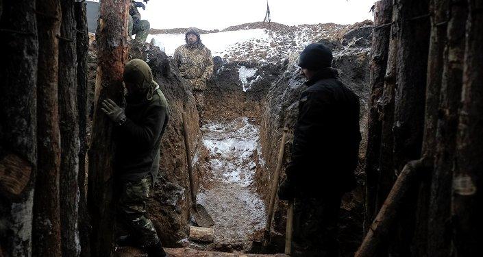 Ukrainian servicemen construct a blindage at their position near Lysychansk, in Luhansk region