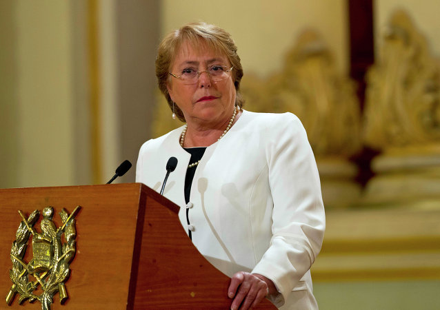 Chile's President Michelle Bachelet listens to Guatemala's President Otto Perez Molina during their joint press conference at the National Palace in Guatemala City, Friday, Jan. 30, 2015